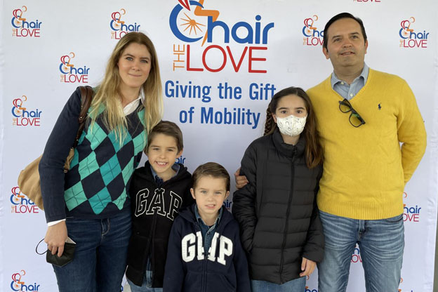 family in front of a chair the love backdrop