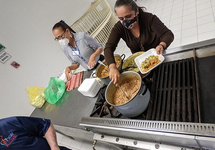 volunteers scooping out food