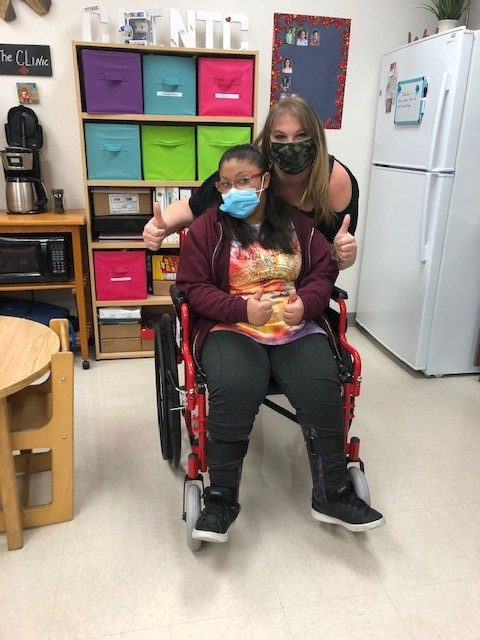 Student with a new wheelchair