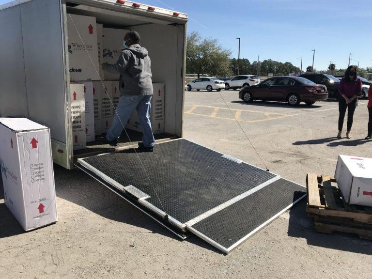 A man unloading boxed wheelchair
